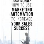 A man in a conference room at work looking at information about What is CRM and How to Use Marketing Automation to Increase Your Sales Success.